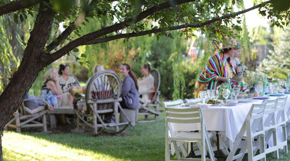 preparing for a group dinner under the apple trees at Casa Gallina in Taos